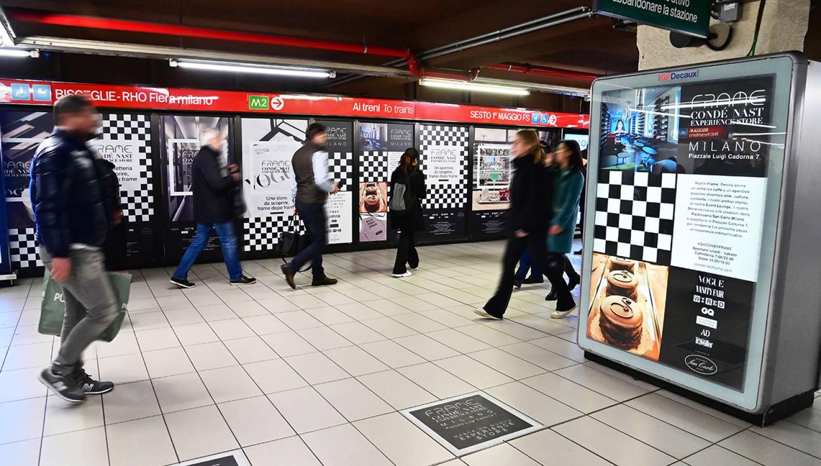 Pubblicità metro Milano IGPDecaux Station Domination per Condé Nast