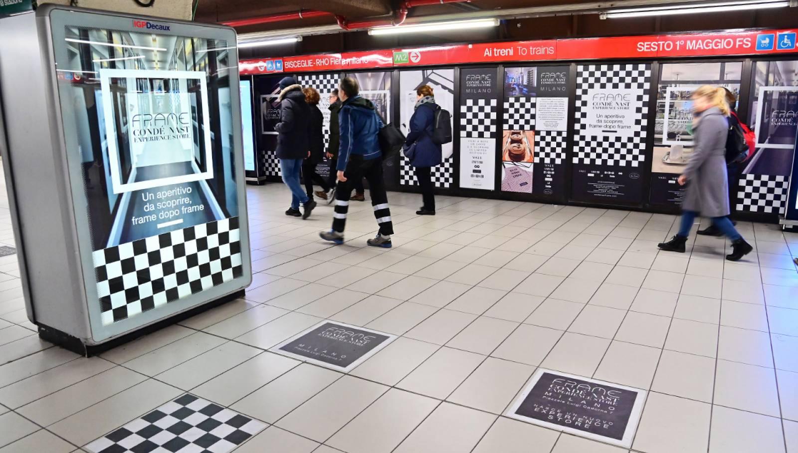 Pubblicità Out of Home IGPDecaux Station Domination Milano per Condé Nast