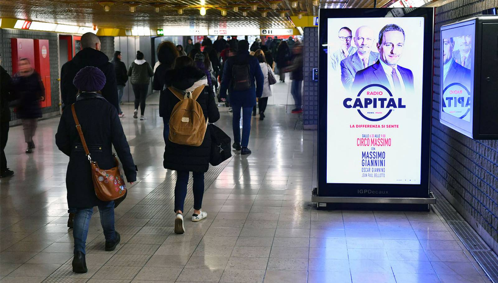 Out of Home advertising IGPDecaux in Milan Underground Vision Network for Radio Capital