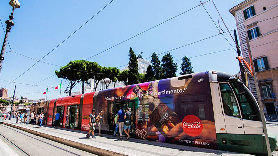 IGPDecaux OOH advertising in Rome Full-Wrap for Coca-Cola