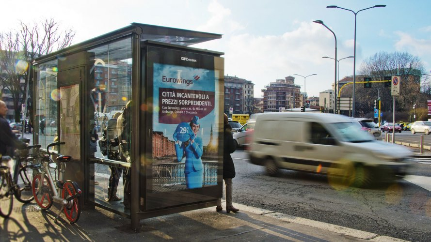Outdoor communication in Milan bus shelter + Mupi for Eurowings IGPDecaux