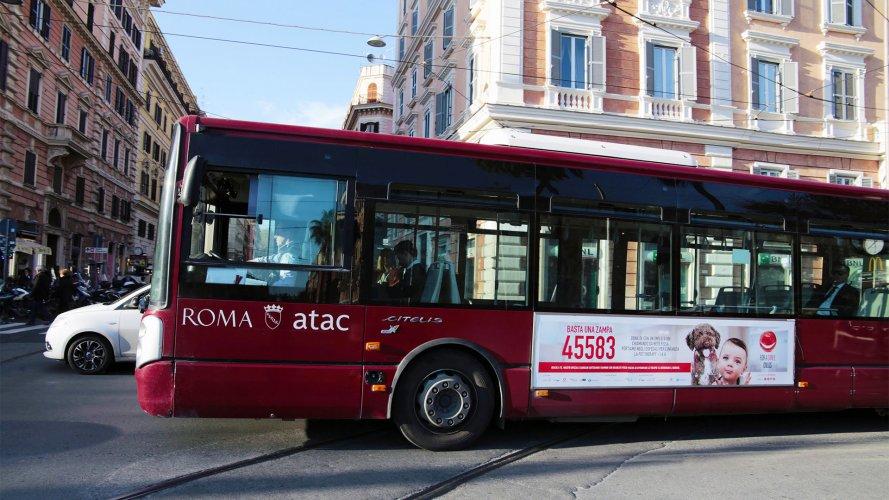Pubblicità sugli autobus Roma IGPDecaux Side Banner For a Smile Onlus