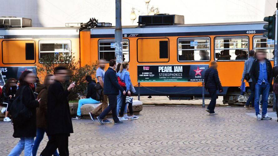 Advertising on tram IGPDecaux in Milan Side Banner for Virgin Radio