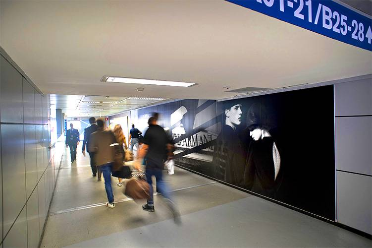 Outdoor advertising IGPDecaux Stickers at Linate airport for Armani