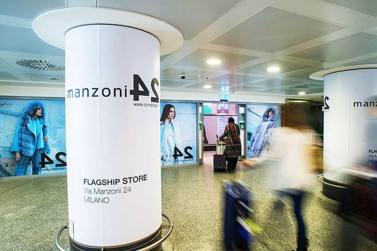 Aeroporto Malpensa pubblicità IGPDecaux Impianti adesiva per Condorpelli