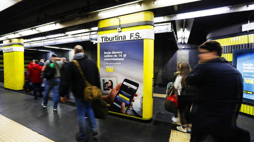 Underground advertising Area station domination IGPDecaux in Rome for Western Union